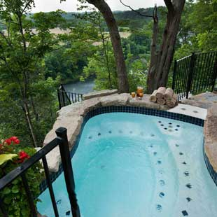 Outdoor bluff-side hot tub overlooking Lake Taneycomo views.
