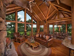 Main living room and dining area overlooking the Lake Taneycomo and Ozarks nature views.