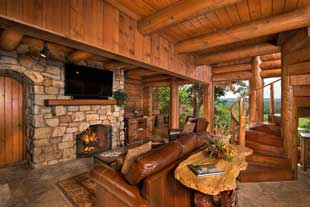 Entertainment area and fireplace on lower level of Bluff House cabin.
