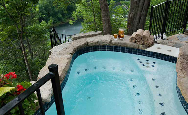 Outdoor hot tub with views of the Ozarks landscape.